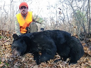 Me posing with the bear, which looks to be about half the size of what it really is.