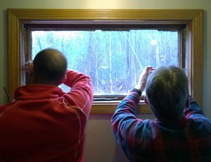Matt and Gary replace an old window in Camp F-Troop's kitchen.